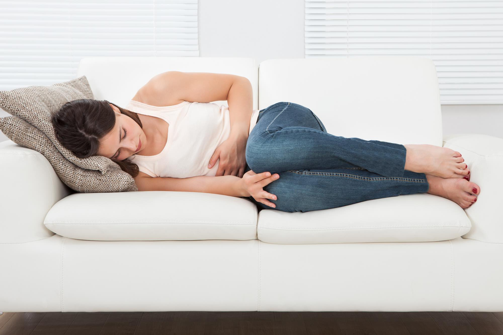 My Pregnant Health | Pregnancy Health Care Tips|woman-suffering-from-stomachache-on-sofa_sizeXL_69b667