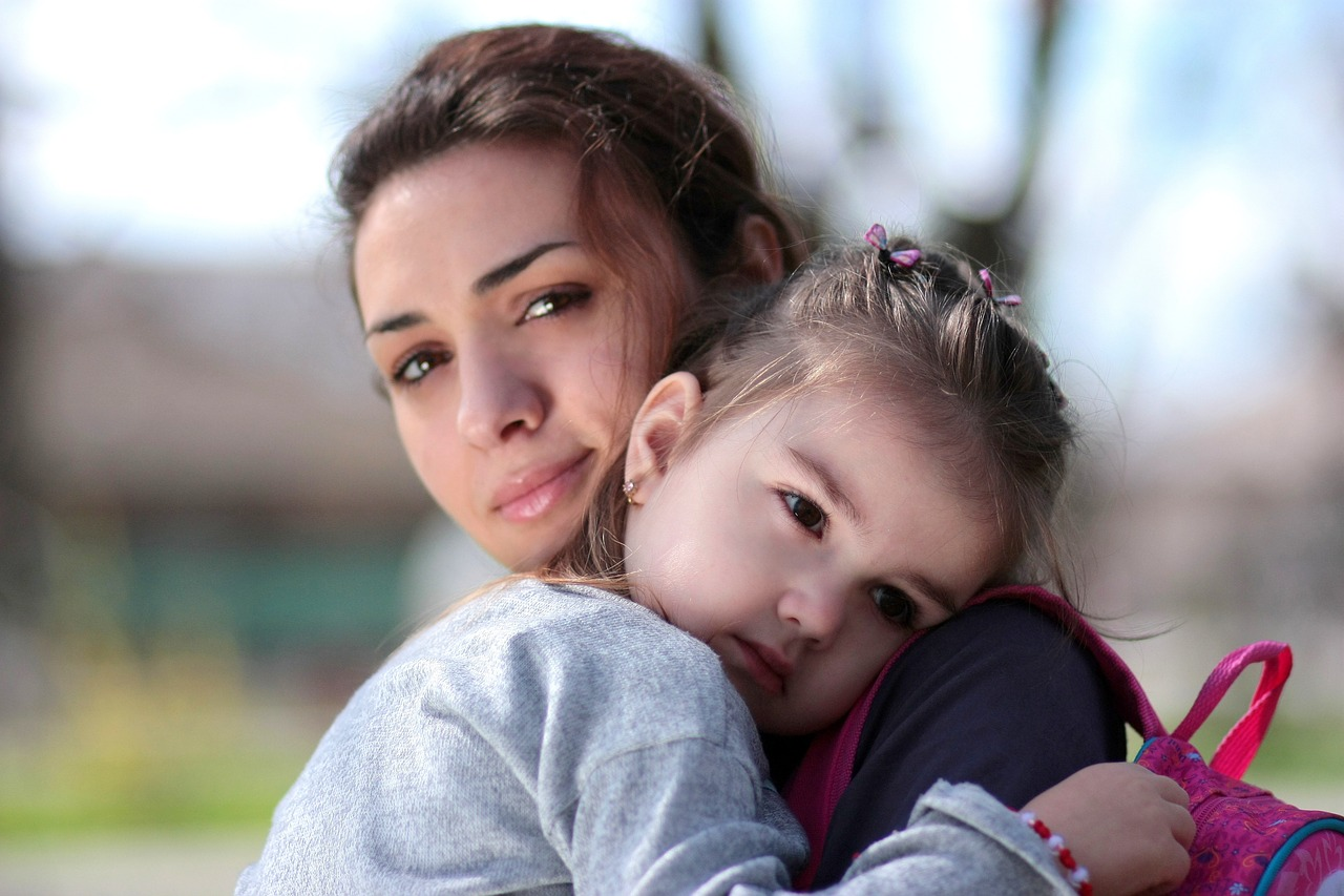 mother holding her daughter in types of parenting style