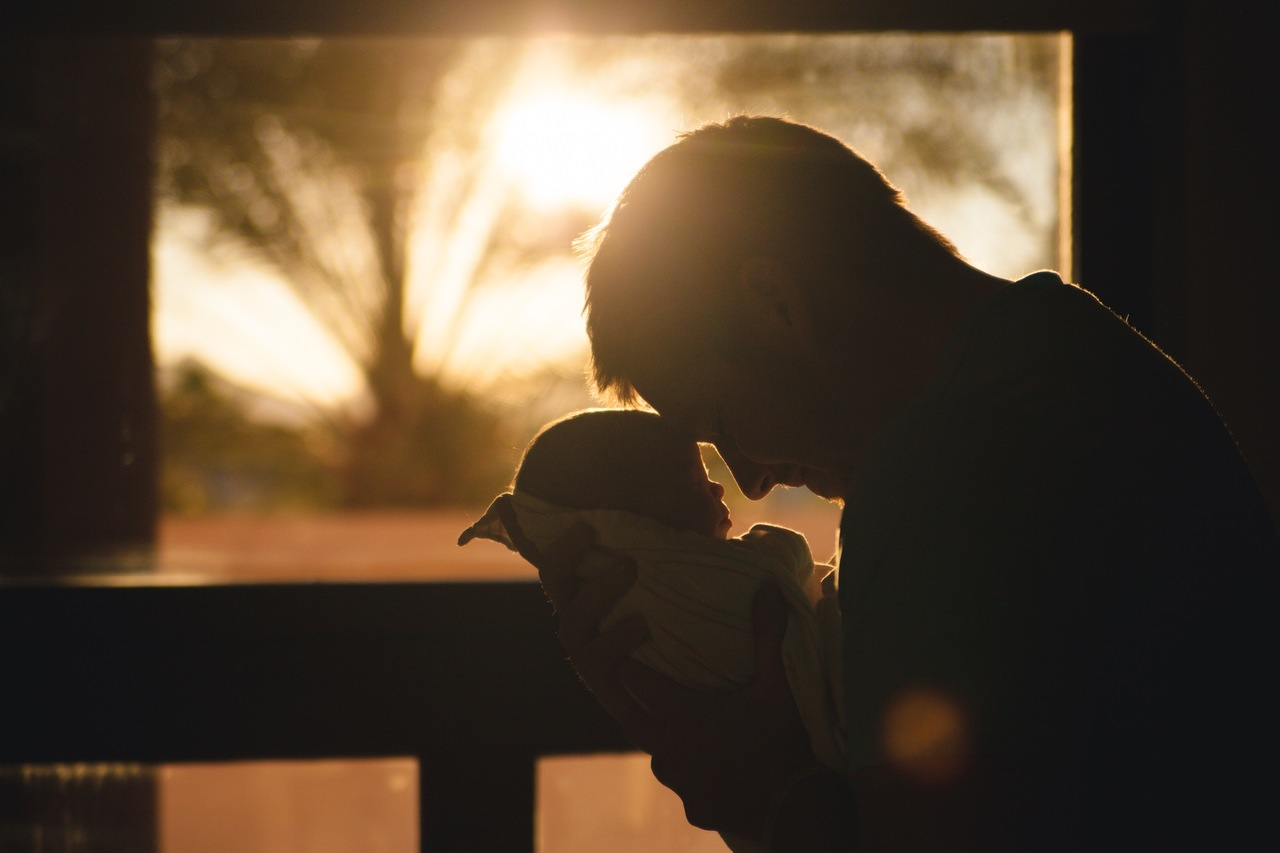 father holding his baby in parenting