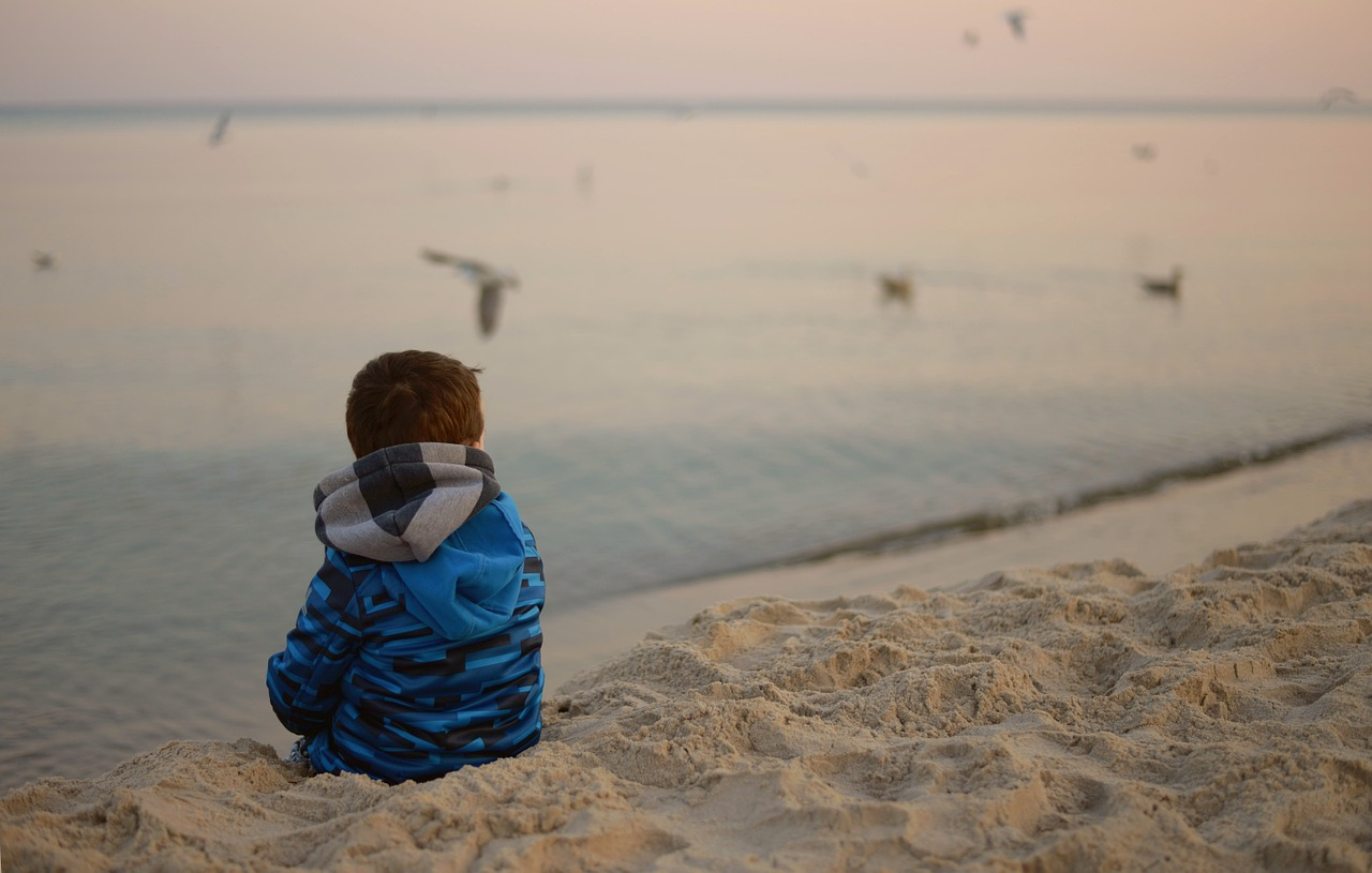 child alone watching in the sea